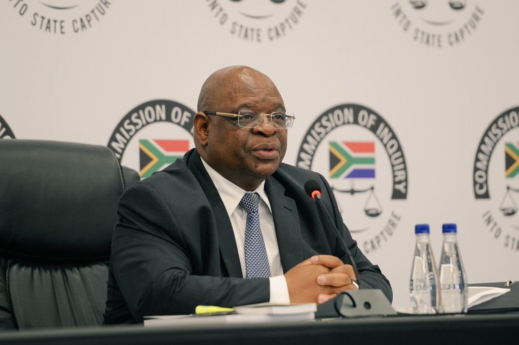 Zondo admits 'family connection' with Zuma